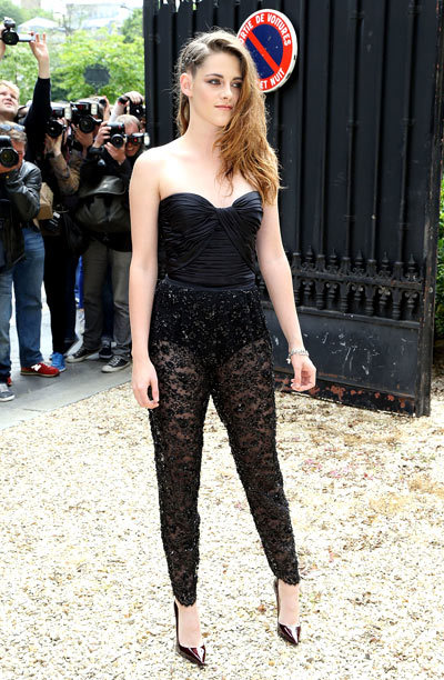 Kristen Stewart makes her entrance at the Zuhair Murad fashion show as part of Paris Fashion Week Haute-Couture Fall/Winter 2013-2014 on Thursday (July 4) at Hotel de Montmorency in Paris, France.