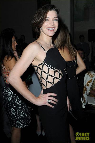 Milla Jovovich at Versace Haute Couture SS show.