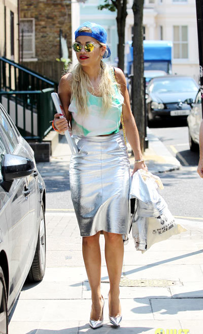 Rita Ora carries her laptop as she heads out for a meeting on Tuesday (July 9) in London, England.