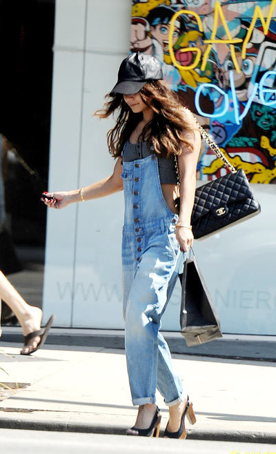 Vanessa Hudgens wearing Joes overalls with heels and her Asos leather cap while out shopping in Studio City, Calif.