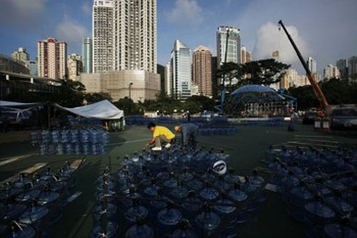 Workers prepare recycled plastic water bottles to be put together as a giant lantern containing 7,000 of such bottles with LED lights, at Hong Kong's Victoria Park September 10, 2013. The