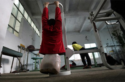 Then 16-year-old Qian Hongyan, from the Yunzhinan Swimming Club for the handicapped, practises doing pull-ups during a daily training session at a swimming centre in Kunming.