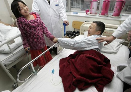 Qian Hongyan, 11, encourages her friend Peng Shuilin (R), who lost his legs in a car accident. Qian first received artificial limbs in 2005 at the China Rehabilitation Centre and has gradually been fitted with bigger limbs due to her body growth.
