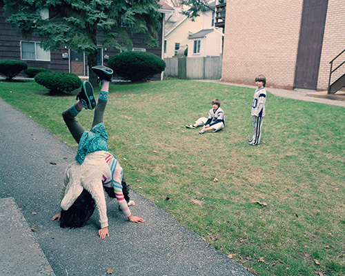 Of course, Clark says, she had preconceptions about what the girls would or would not be able to do. When they did a handstand, the first time I met them, they shattered any ideas I had about how mobile theyd be. I think they wanted to show me what they were capable of. At first they were curious about Clarks equipment and the process of photography  what does a light meter do? Whats with the camera that doesnt have a screen on the back?  but before long they forgot the camera was there.