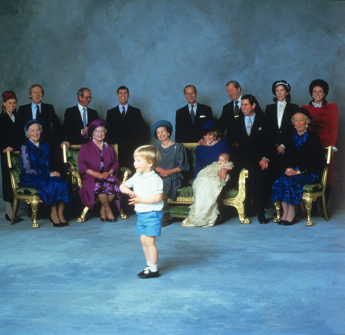 Prince William's high spirits at his brother Harry's christening in 1984 reduces everyone to giggles.  This group picture was taken after the service in St Georges Chapel, Windsor, performed by the then Archbishop of Canterbury, Dr Robert Runcie. Photo: © PA