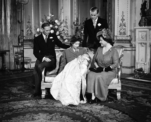The boys' father Charles at his christening in December 1948. Photo: © PA