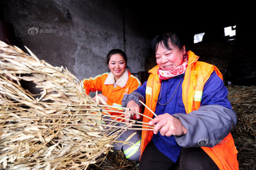 Guo also learned how to tie a broom from a senior colleague. She covers 1.235 million square meters' streets.