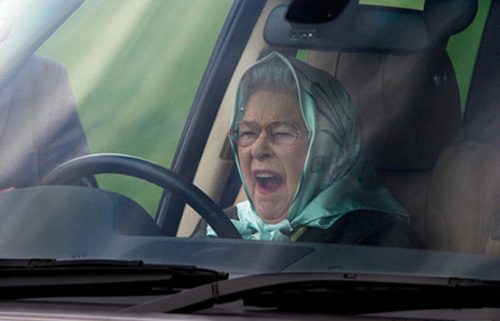 Queen Elizabeth II yawns at the Royal Windsor Horse Show, in Windsor, Britain.