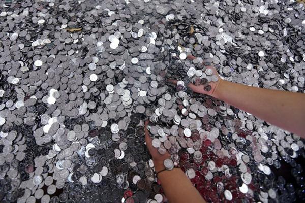 750px-coins-7189-1400292355.jpg
