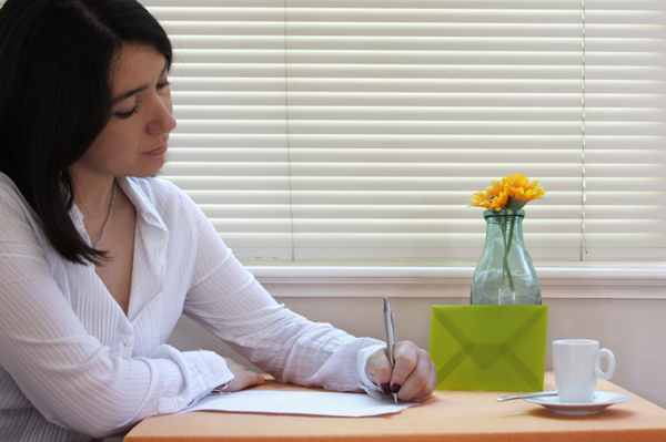 woman-writing-letter-9605-1401329805.jpg