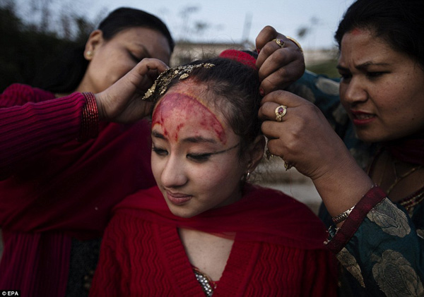 The Gufu ceremony is a grand occasion and marks the start of a time when the child can go to school, return to their families and live in public, after years of being unable to do all those things. Here, Purna Shova, left, unties the hair of her daughter, Kumari Samita Bajracharya, at Bagmati river in Patan, Nepal