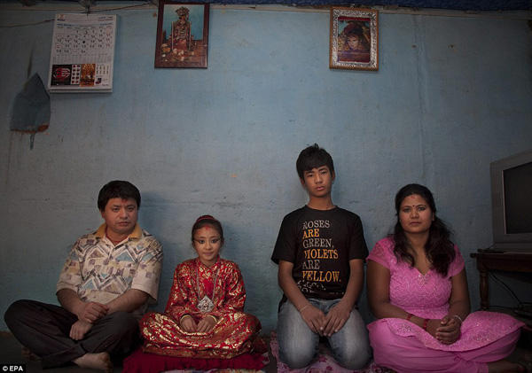 After the Gufa, Kumari Samita Bajracharya's life with her father Kul Ratna Bajracharya, left, mother Purna Shova, far right, and elder brother Sabin, right, will revert to the life of any other ordinary young girl - a life she has never known