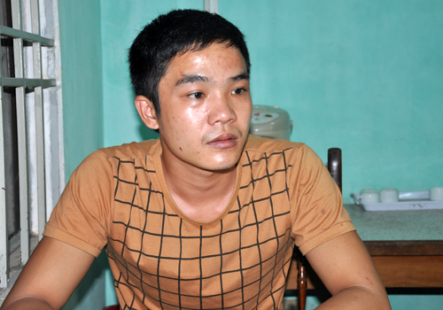 Hung thủ Nguyễn Mai Hoàng Long tại cơ quan công an.