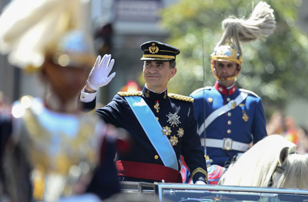 Spain's King Felipe VI waves on his way from the Congress of Deputies, Spain's lower House, to the Palacio de Oriente or Royal Palace in Madrid on June 19, 2014 following a swearing in ceremony of Spain's new King before both houses of parliament.