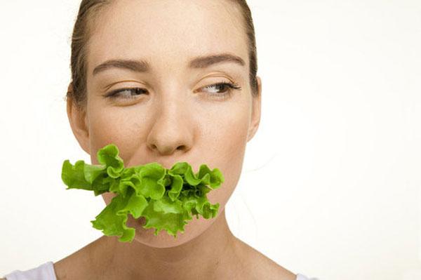 woman-eating-lettuce-2101-1403687801.jpg