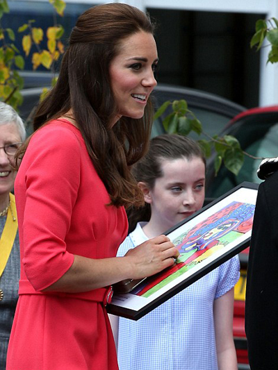 Kate was presented with a Picasso style portrait of herself holding Prince George. The framed picture was given to thank her for visiting