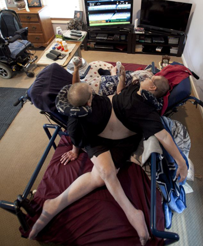 he men play a Nintendo Wii at the home. The brothers, born October 28, 1951, are hoping to be recognized later this year as the world's oldest conjoined twins, when they turn 63