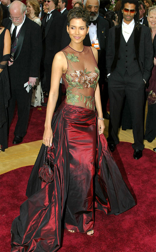 March 24, 2002Sheer genius! The Monster's Ball actress played peek-a-boo in a stunning merlot gown that featured a sexy see-through bodice adorned with strategically place embroidery at the Oscars in Hollywood.