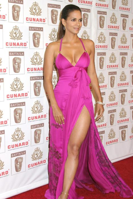 November 2, 2006At the BAFTAs in L.A., the Their Eyes Were Watching God actress flaunted her shoulders and showed some leg in a foxy fuchsia gown with a hip-high slit and accessorized with giant gold hoop earrings.
