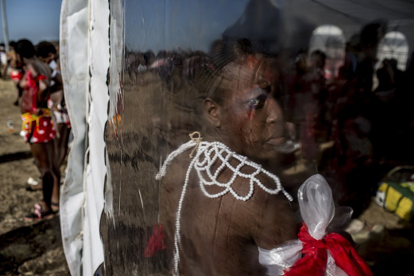 A girl prepares herself inside a marquee for the dance.