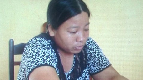 [Caption]An Thị Thêu tại cơ quan điều tra.