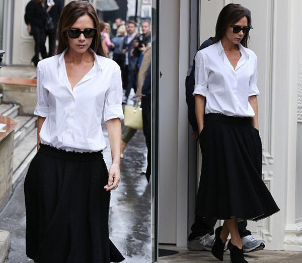 Bà Becks thanh lịch với trang phục đen trắng tới cửa hàng hôm 29/9.