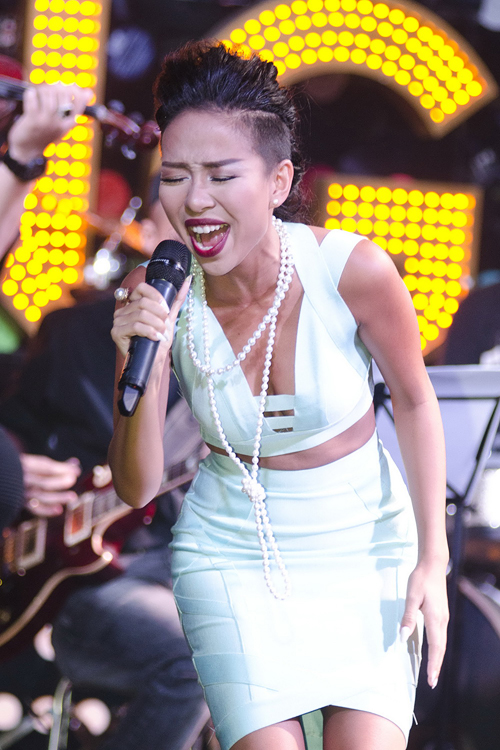 ca-si-Thao-Trang-2-5474-1414207632.jpg