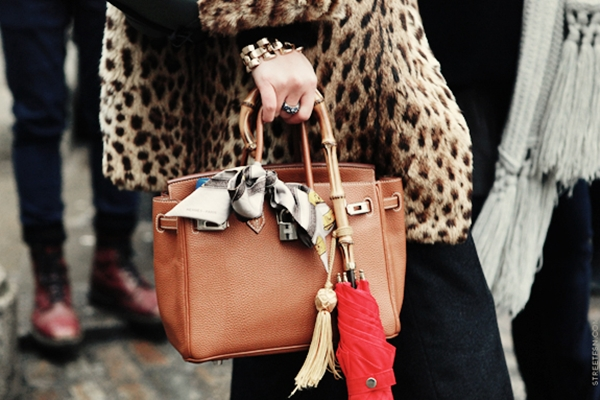 silk-scarf-tied-onto-leather-bag.jpg