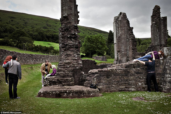 Owners Clemens (left), Robert (centre) and Shadowman (right) arrange their dolls for a photoshoot at Llanthony Priory abbey in south east Wales. Clemens had forgotten to bring shoes for his doll Mariam, but Robert had brought an extra pair for his doll Cathy so shared them with his friend