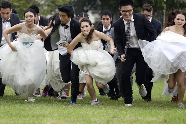 Couples participate in the Running of the Brides race in a park in Bangkok November 29, 2014.