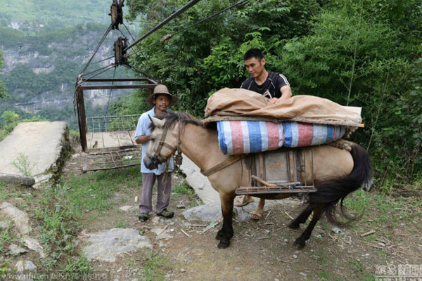 Villagers prepare to deliver items out of their village.