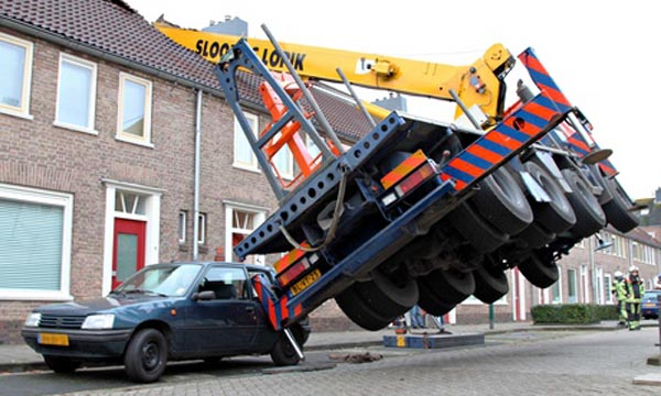 The crane that fell on to the roof of a house in IJsselstein, central Netherlands, during the marriage proposal. Photograph: Michiel Van Beers/EPA