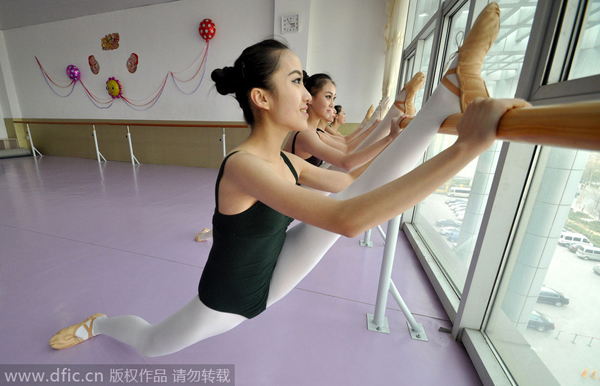 Students stretch out before the dance practice at a high school in Handan, Hebei province on December 20, 2014