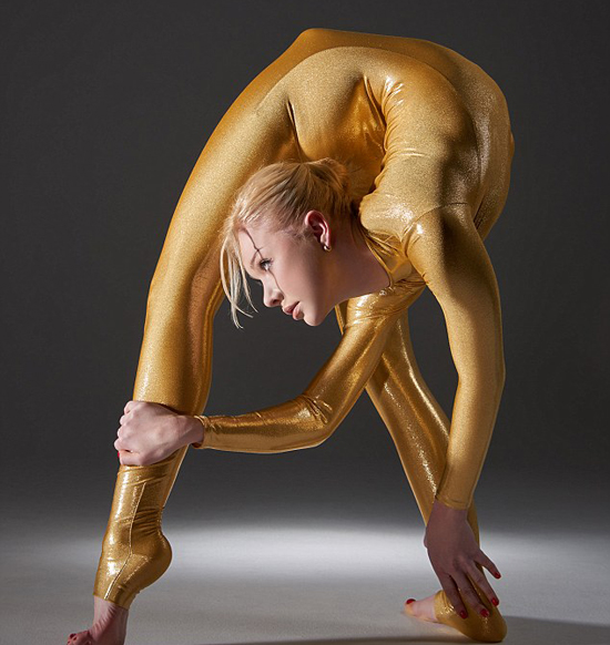 Russian-born Zlata twists herself into the most extreme poses imaginable wearing a slinky skin-tight gold jumpsuit. Casting shadows against the white back drop as she holds impossible positions in the dramatic shots, Zlata looks a little like an abstract modern art statue.