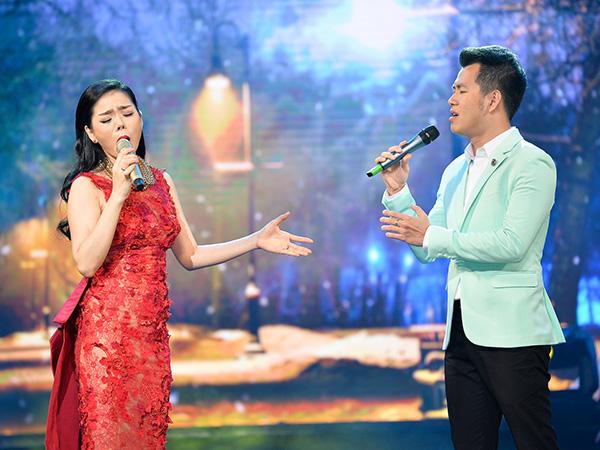 [CaptionThật cảm xúc và khó phai, ngay trên sân khấu của TKVTG, khán giả đã chứng kiến sự kết hợp tuyệt vời của hai giọng hát Lệ Quyên  Hồ Trung Dũng trong sáng tác Xin còn gọi tên nhau.