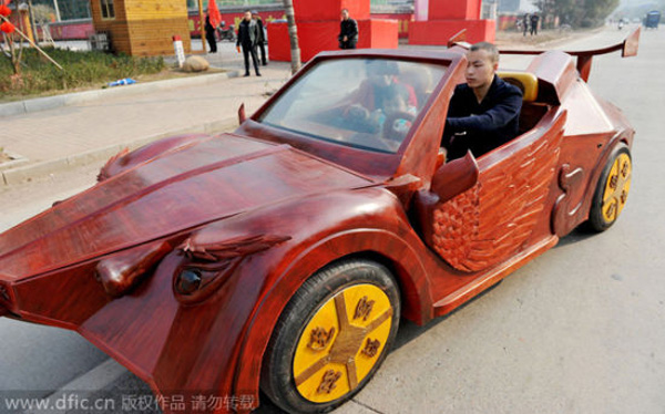 Chinese farmer Yu Jietao drives his homemade wooden sports car with his family on a road in Guangfeng county, Shangrao city, East China's Jiangxi province, February 9, 2015.