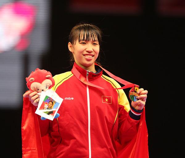 Võ sĩ Kim Tuyến vừa mang về tấm HC vàng thứ 3 cho teakwondo trong ngày đầu ra quân.