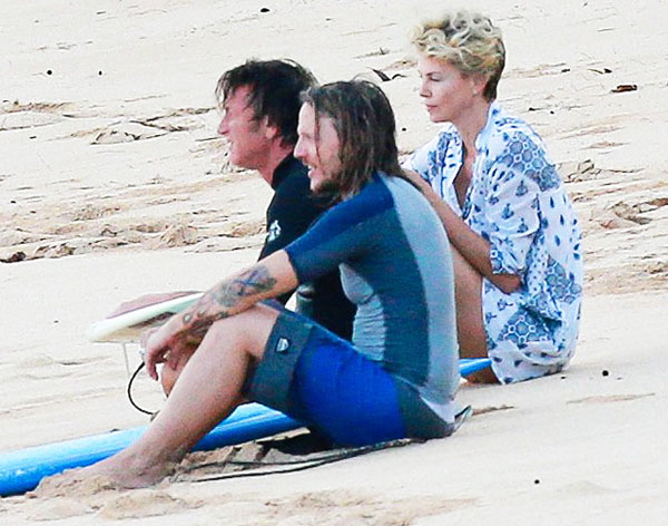 Rumors are swirling! Theron and Penn first caused a frenzy when they were spotted ringing in the New Year together in Hawaii.