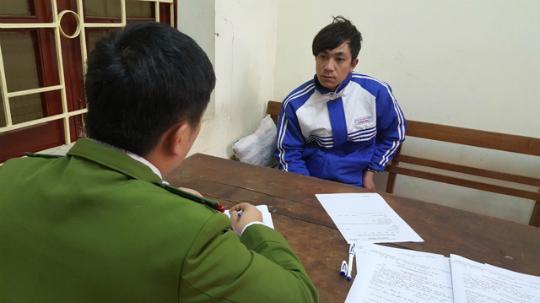 Đối tượng Trần Văn Giang tại cơ quan điều tra. Ảnh do công an cung cấp.