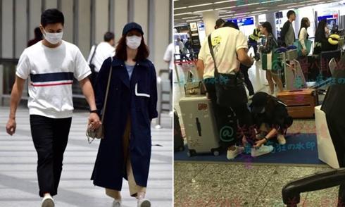 Lưu Thi Thi chu đáo buộc dây giày giúp chồng