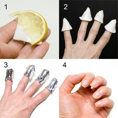 Làm trắng móng tay bị ố màu bằng cách ngâm bông cotton vào nước cốt chanh, bọc lên các đầu ngón tay rồi phủ thêm một lớp giấy bạc ra ngoài.