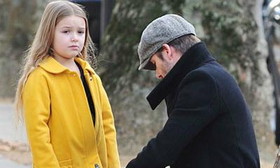 'Tiểu thư' Harper phụng phịu đi dạo với bố