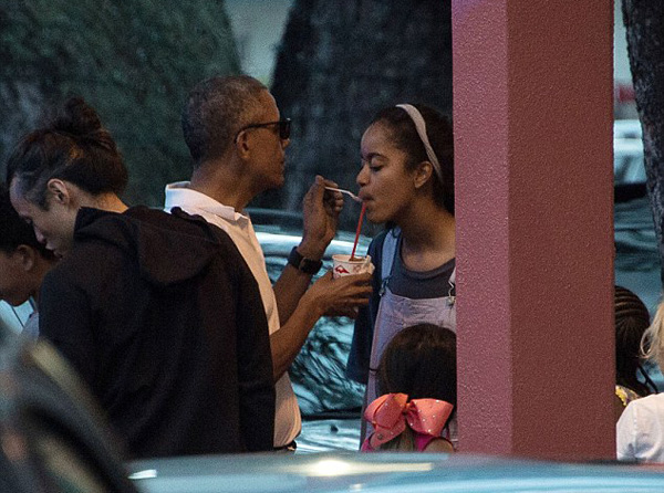 First Daughters Malia, 18, and Sasha, 15, joined their father to unwind on the east side of the island on Christmas Eve with some local style shave ice at Island Snow in Kailua.  Read more: http://www.dailymail.co.uk/news/article-4064680/She-s-daddy-s-little-girl-Obama-feeds-Malia-shave-ice-spending-day-Escape-Room-daughters.html#ixzz4TvbKcRKY  Follow us: @MailOnline on Twitter | DailyMail on Facebook