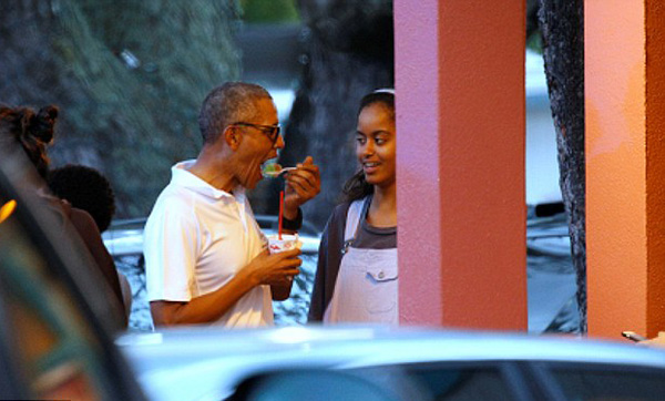The President seemed to enjoy his choice of flavors that he put on the shaved ice as he continued eating it while chatting with Malia (above)