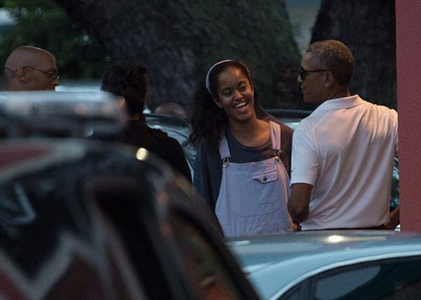 Malia had a few laughable moments (above) with her father as the two seemed to enjoy the Christmas Eve outing
