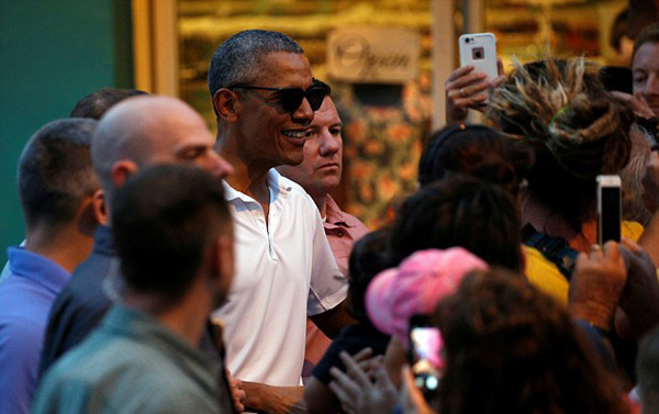 Although Secret Service sectioned off the entire block, tourists and local shopkeepers quickly got wind of President Obamas appearance in the neighborhood and flocked to both sides of the block hoping to catch a glimpse.