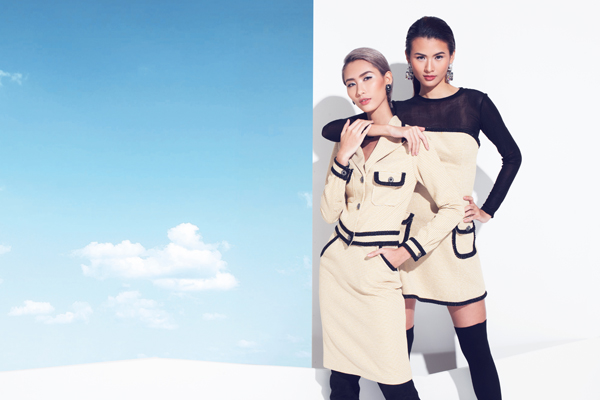 Chất liệu vải tweed phối túi nắp hộp viền đen trẻ trung và cá tính kết hợp cùng đầm ống kèm áo voan lưới, tạo sự kín đáo, đầy gợi cảm.