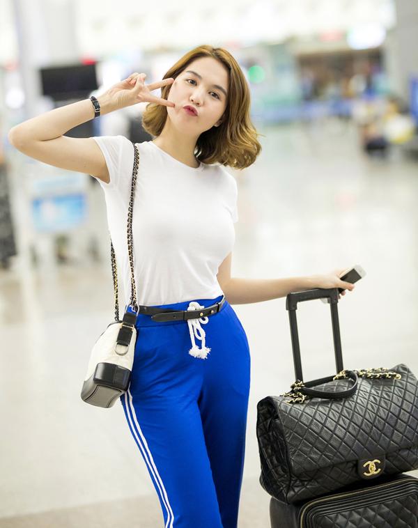Ngọc Trinh mặc quần ống thấp ống cao ra sân bay - Ảnh minh hoạ 2