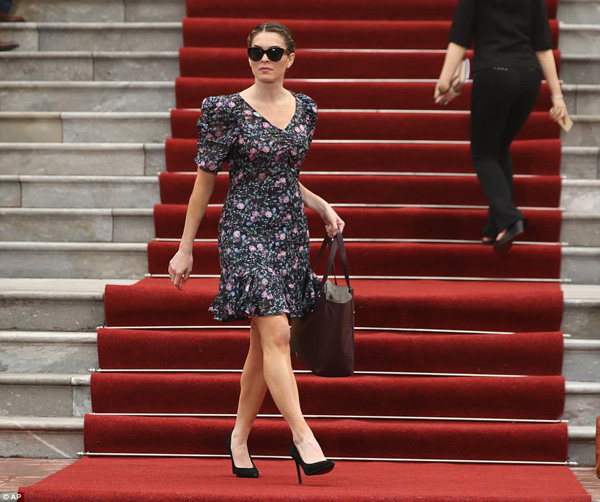 The White House communications director donned a pretty floral number as she walked into a news conference between President Donald Trump and Vietnamese President Tran Dai Quang at the Presidential Palace on Sunday. The dress was ruffled at the hem, which rested just above the knee, and puffed at the shoulders, much like the grey sweater she wore earlier in the trip when Trump addressed the National Assembly in Seoul.
