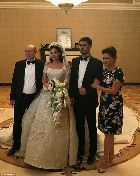 Ganya Usmanova, the niece of Arsenal shareholder Alisher Usmanov, wed her tennis star groom Vazha Uzakov (pictured with his bride and parents) in a lavish ceremony funded by her oligarch uncle over the weekend